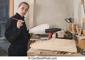 Carpenter - Young carpenter in his workshop with craft...
