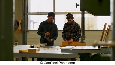 Carpenters working in workshop 4k