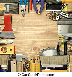 Carpentry tools on a wooden board.