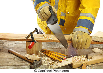 carpentry - carpenter's hands - working with saw