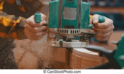 Carpentry indoors - a woodworker polishes a top of wooden ...