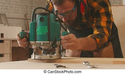 Carpentry industry indoors - man worker in protective ...