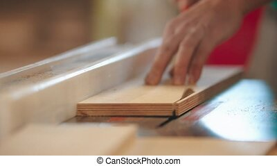 Carpentry industry - man cutting out the piece of wood. Mid ...