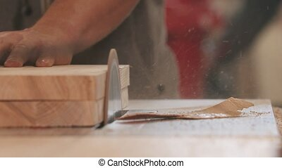 Carpentry industry - man grinding the side on the piece of ...