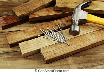 Carpentry still life - Hammer and nails on wood