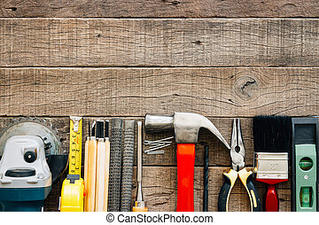 carpentry tools equipment on grain wood on top view