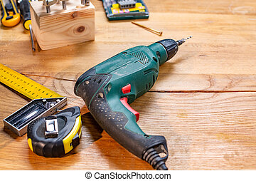 carpentry workshop drill and other tools lie on the table
