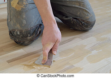 Carpet fitter gets putty.