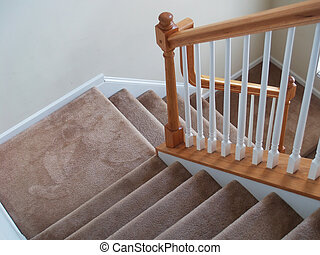 Carpeted Stairs - A view down a stairway in a modern ...
