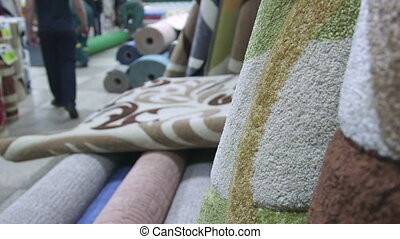 Carpets and rugs in store staff serving customers