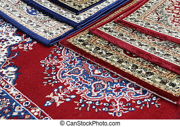 carpets decorated in an islamic mosque - many colored...