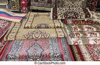 carpets for sale in the ethnic market stall - many carpets...