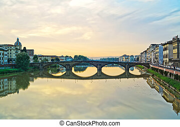 Carraia medieval Bridge on Arno river, sunset landscape....