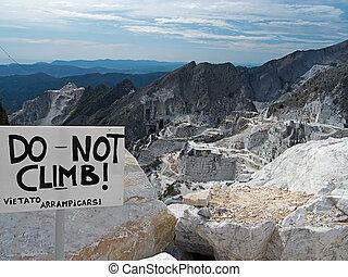Carrara marble quarries view and sign - No climbing!