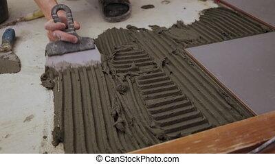 carreau, ouvrier, mettre, plancher, colle