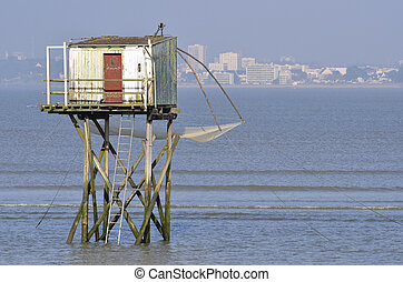 Fishing carrelet from Saint Brevin les Pins and the town of Saint Nazaire in the background in Pays de la Loire region in western France