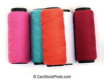 carrete, thread., coloreado