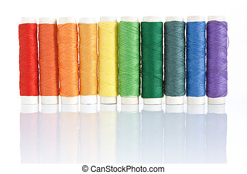 carretes, hilos, colorido