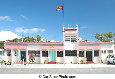 small airport with grenada flag