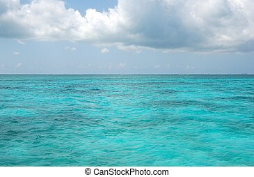 Carribean Sea against the sky with Clounds - The Aqau water...