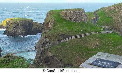 Carrick a Rede rope bridge on sea, Ireland, tourism...