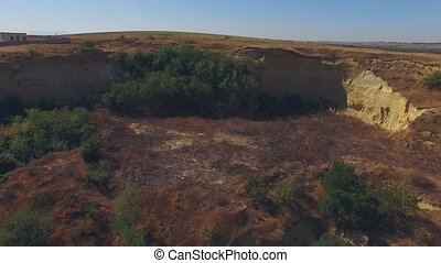 Carrier Slope Littered With Waste - AERIAL VIEW. Overall...
