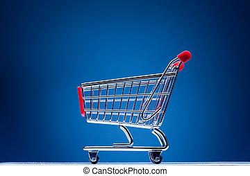 carro de compras, en, fondo azul