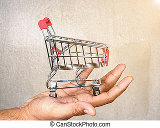 carro de compras, en, mano