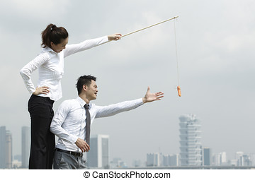 Carrot and Stick - Conceptual image about motivation and...