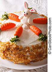 carrot cake with candy bunny close-up on the table. Vertical