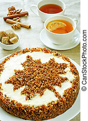 carrot cake with raisins, walnuts and butter cream on a ...