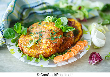 carrot fritters with herbs on a plate
