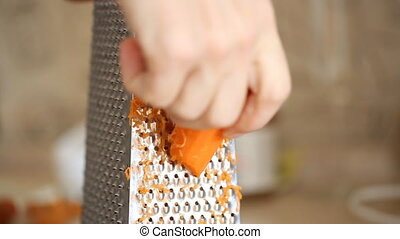 Carrot grating on metal grater