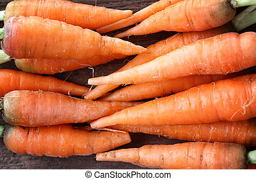 Carrot isolated in wood background