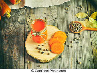 Carrot juice in a glass jar