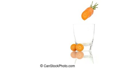 carrot juice poured into glass isol