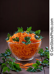 Carrot salad on a wooden table.