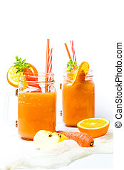 Carrot smoothie in a jar isolated