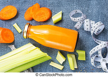 carrot smoothie with orange and cinnamon in glass jar and ingredients, detox drink