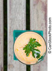 Carrot smootie with fresh parsley leaves