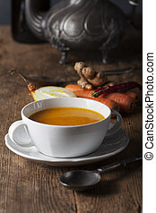 carrot soup in a white bowl