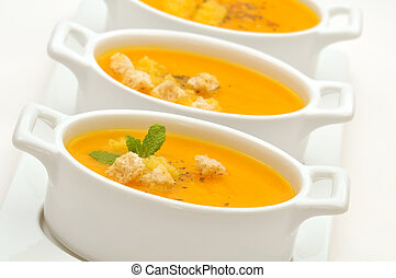 Carrot veloute - Carrot creamy soup served in small ceramic...