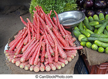 carrots and other vegetables in Delhi street market