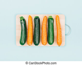 Carrots and zucchini on a chopping board