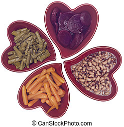 Carrots, Black Eyed Peas, Beets and Asparagus in Heart Shaped Bowls Isolated on White with a Clipping Path.