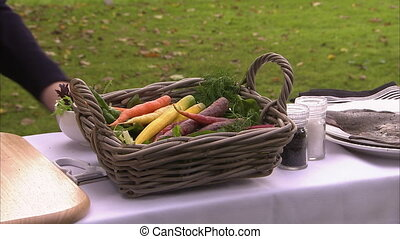 Carrots in a basket - A medium steady shot of vegetables in...