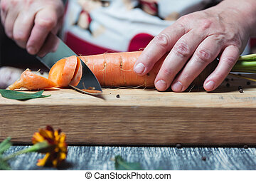 Carrots on a chopping board with knife