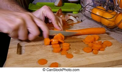Carrots on Chopping Board - Chopping Carrots on Wooden...