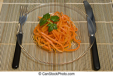 Carrots salad on the glass plate