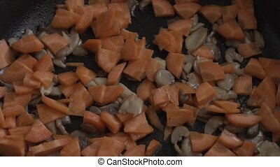 carrots with mushrooms to fry in a pan.
